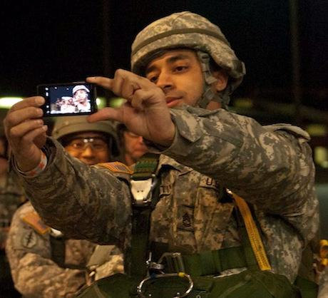 soldier carrying smart phone
